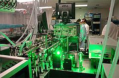 Scientistpreparingexperimentoutsideofcontainedfiringtank